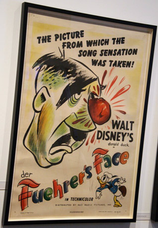 In Der Feuher's Face poster as it hangs in the Disney Family Museum