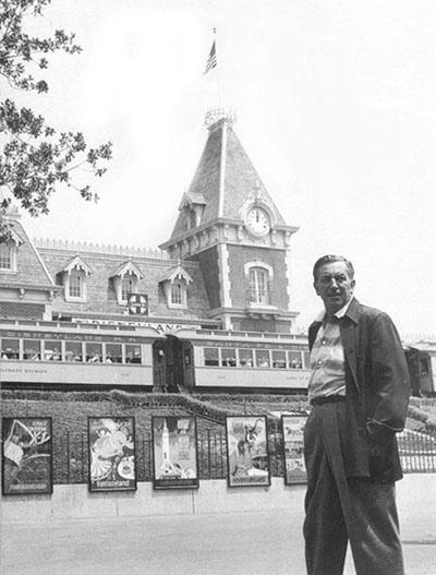 Walt Disney in front entrance of Disneyland